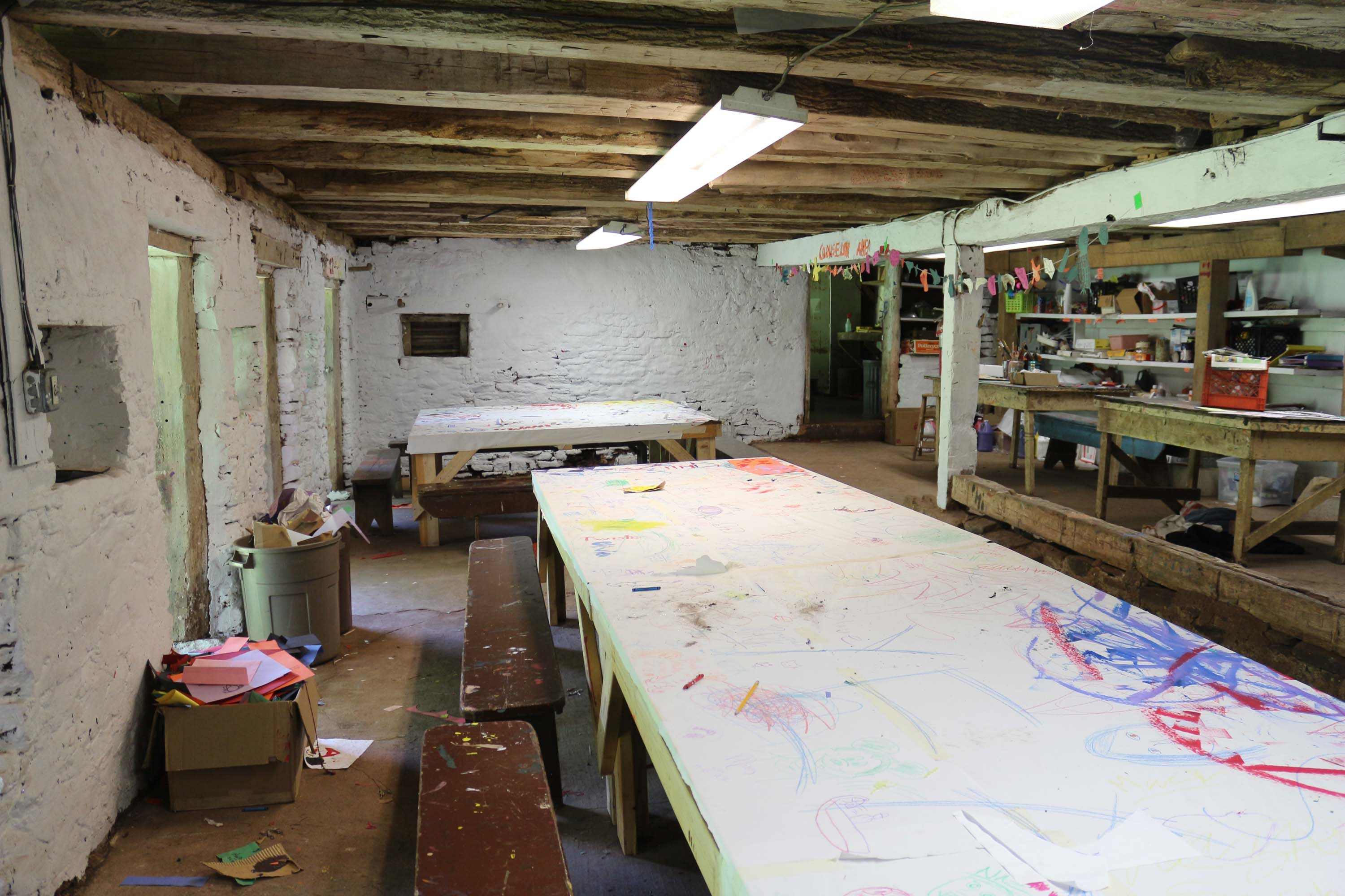 Located in the basement of our barn, the Arts and Crafts area is nice and cool on hot days, and is a great place to get creative.